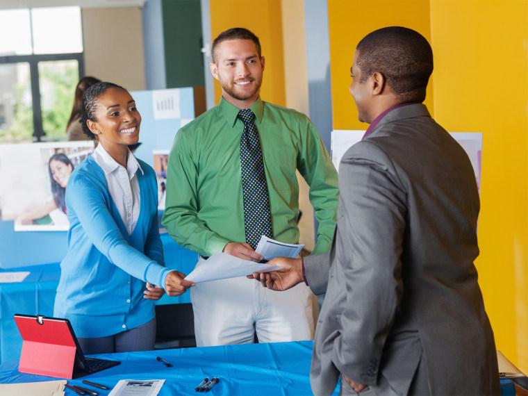 Professional businessman seeking employment at job fair event