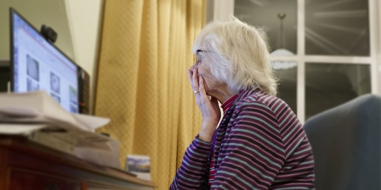 Old elderly senior person learning computer and online internet skills protect money scam and fraud