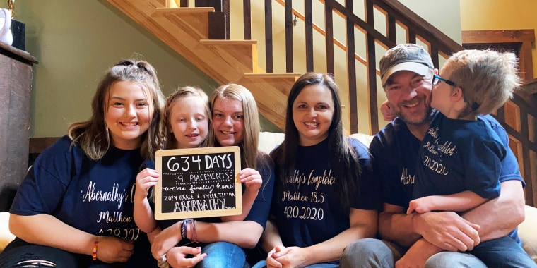 The Abernathy family after adopting two young kids, Tyler and Zoey.