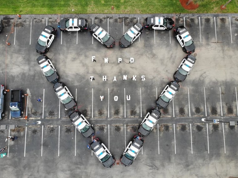 The Fort Myers Police Department makes heart out of police cars to thank health workers at Lee Memorial Hospital