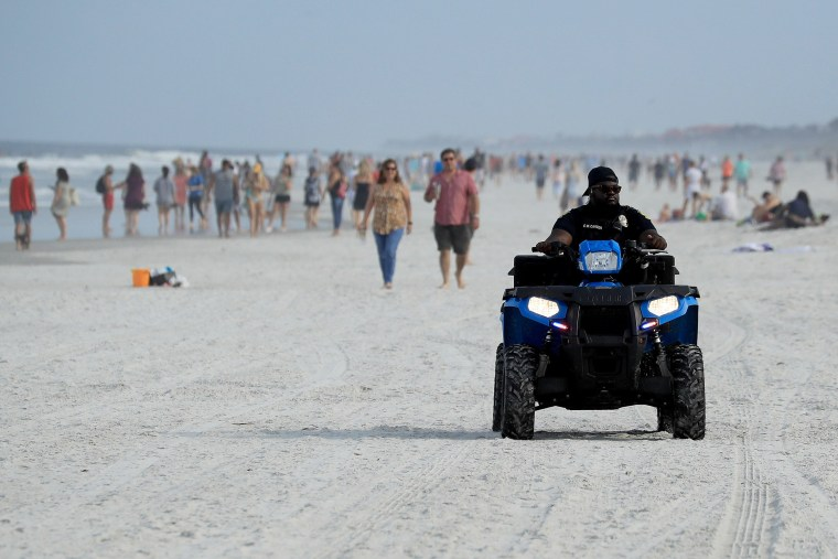 Image: JPolice drive down the beach on April 19, 2020 in Jacksonville Beach, Florida