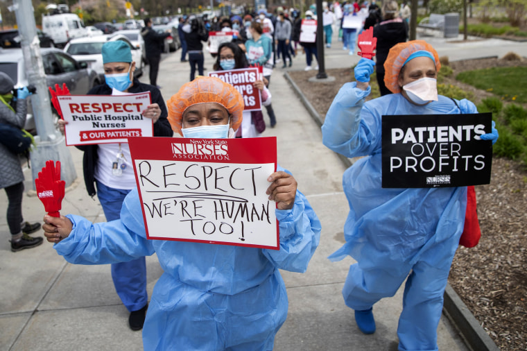 Image: Nurses protest a new sick leave policy requiring a doctor's note outside of Jacobi Medical Center in the Bronx, N.Y., on April 17, 2020.