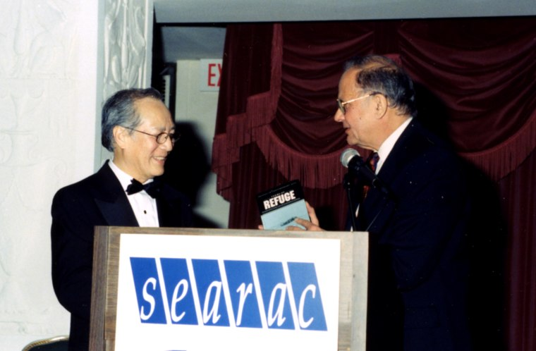 """Image: Le Xuan Khoa receives an award at the organization's """"Thank You America: Two Decades of Refugee Resettlement"""" gala in 1998."""