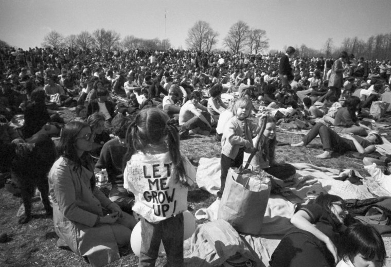 "A young girl wears a ""Let Me Grow Up"" sign as residents mark Earth Day in Philadelphia's Fairmount Park on April 22, 1970."