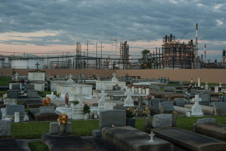 """A cemetery stands in contrast to the chemical plants that surround it in """"Cancer Alley"""" near Baton Rouge, La."""