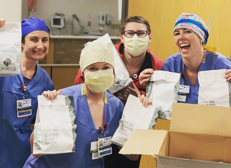 Hospital staff at the Swedish Medical Center in Englewood, Colo., receive a lunch delivery from the restaurant Birdcall.