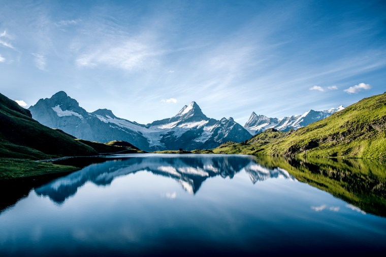 Scenic View Of Lake And Mountains Against Blue Sky in Switzerland
