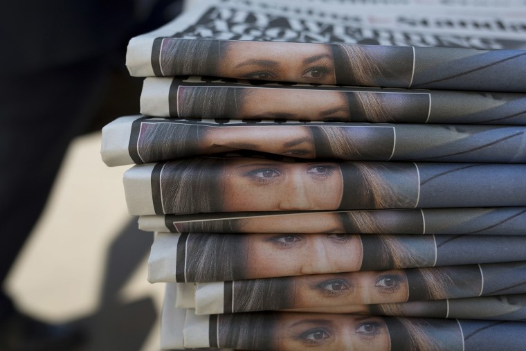 A stack of Evening Standard newspapers in London features the eyes of Meghan Markle.