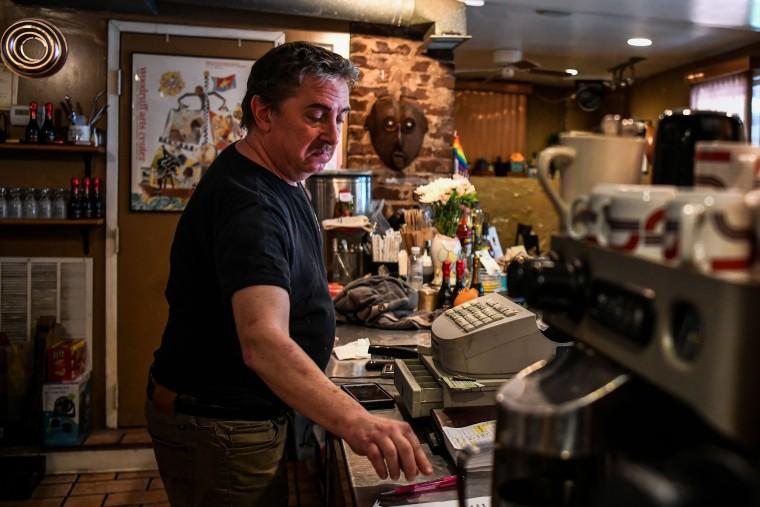 Image: Randy D. Adler, works at his restaurant in Atlanta, Georgia, on April 23, 2020