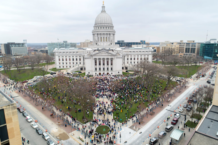 Image: Protesters against the state's extended stay-at-home order demonstrate in Madison