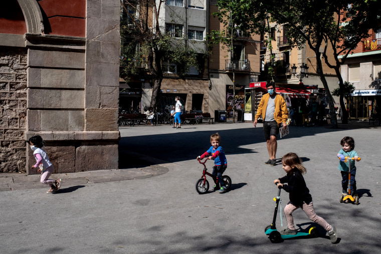 Image: Children play on the streets of Barcelona on April 26, 2020. Spain eased some lockdown restrictions, now allowing children to leave their homes for up to an hour per day.