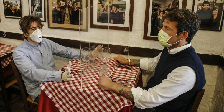 Coronavirus emergency - Restaurant plexiglass separator, Rome, Italy - 23 Apr 2020
