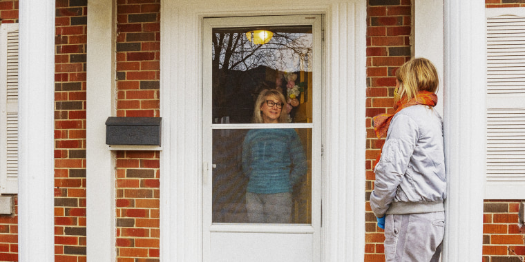Neighbors helping each other.  A friend drops by for a chat on the doorstep.