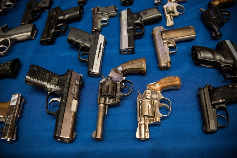 Image: Guns seized by the New York Police Department at a press conference on Aug. 19, 2013.