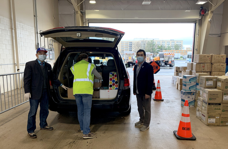 James Chuang, an adviser of Taiwan's Overseas Community Affairs Council in New York, and others load up a van to deliver supplies to Queens' hospitals.