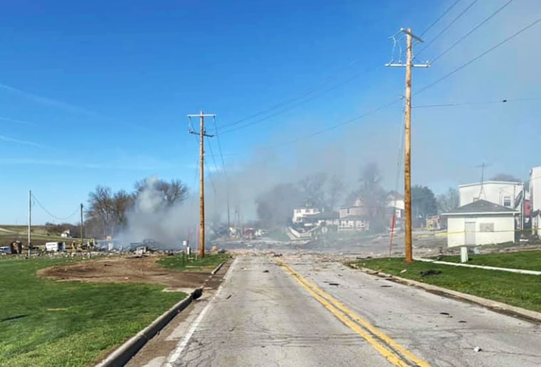 Smoke fills the air above a gas station in Earling, Iowa