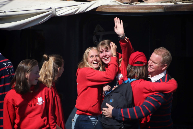 Image: Twenty-five Dutch students celebrate as relatives cheer them upon their arrival on the sailing ship Wylde Swan at the port of Harlingen