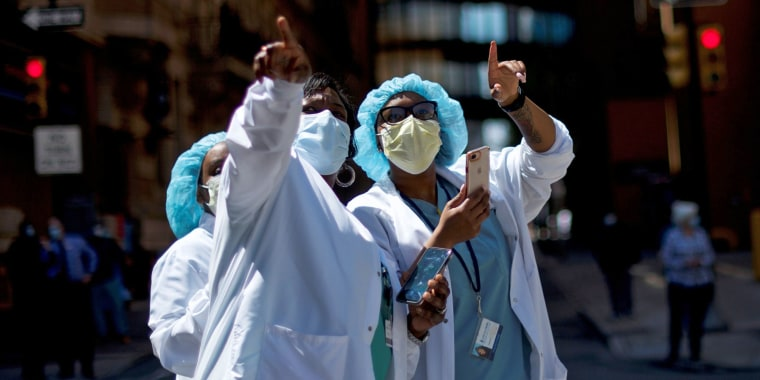Image: Healthcare workers react as they watch a flyover in Philadelphia