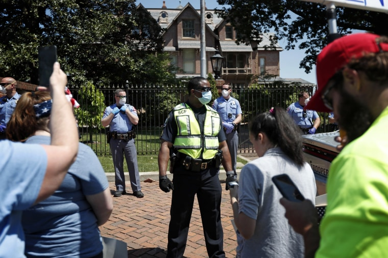 Image: Protesters with ReOpen N.C. are blocked by police outside of the governor's mansion in Raleigh on April 28, 2020.