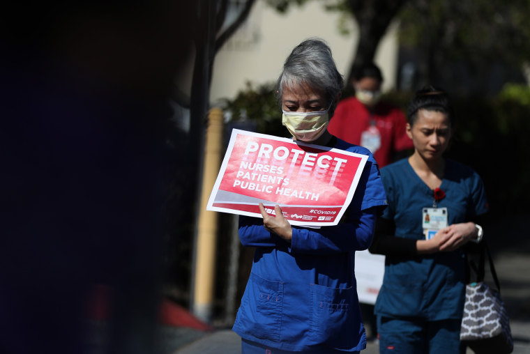 Image: Health care workers protest to demand better working conditions and proper personal protective equipment outside a hospital in Alameda