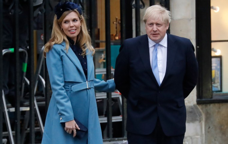 Image: Britain's Prime Minister Boris Johnson with his partner Carrie Symonds leave after attending the annual Commonwealth Service at Westminster Abbey in London.