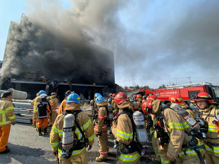 Image: Firefighters working at the scene of a fire at a warehouse in Icheon on South Korea