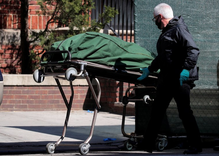 Image: The body of a deceased person is prepared to be transferred at the Brooklyn Hospital Center, during the outbreak of the coronavirus disease (COVID-19) in the Brooklyn borough of New York City