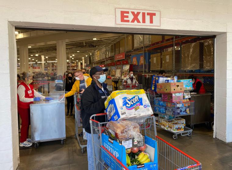 Image: Shoppers exit a Costco store in Arlington, Va.