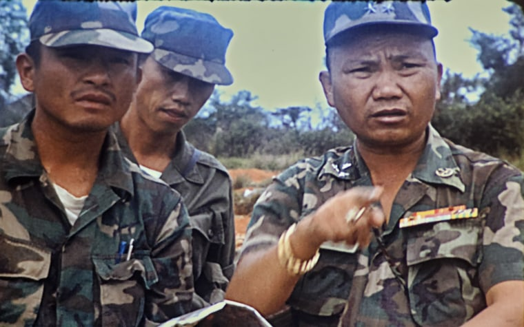 Tou Long Yang, left, and General Vang Pao of the Royal Lao Army, right, at the Plain of Jars in 1971.