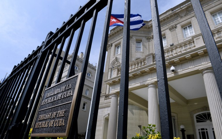 Image: The Cuban flag flies in front of the country's embassy after 54 years July 30, 2015 in Washington, DC.