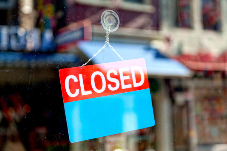 Closed sign in a window