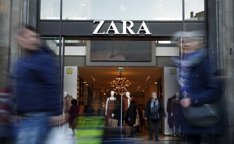 People walk past a Zara store in Barcelona