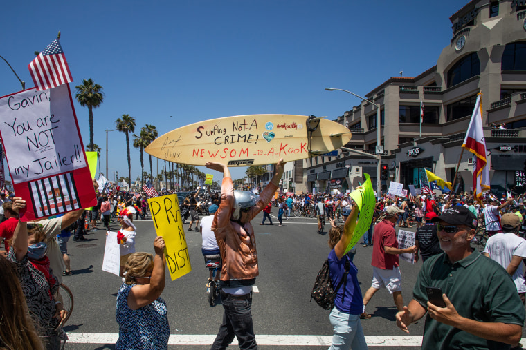 Image: Protest To Reopen California Businesses, Beaches, And Parks Held In Huntington Beach