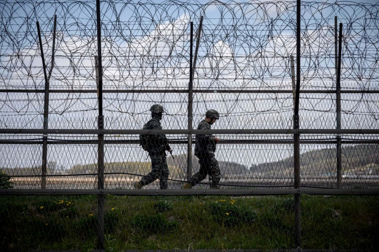 Image: South Korean soldiers patrol the barbed wire fence of the Demilitarized Zone separating North and South Korea on April 23, 2020.