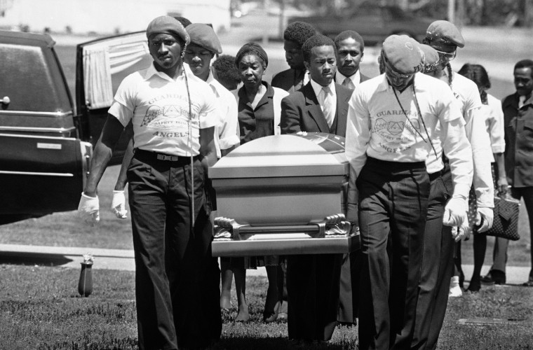 Image: Guardian Angels and relatives carry the casket of Michael Cameron McIntosh, 23, who was killed in Atlanta in 1981.