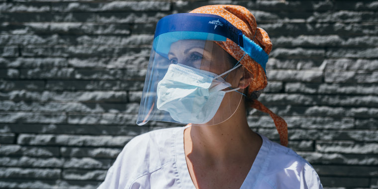 Kelly Houlihan in the personal protective equipment she wears as an ICU nurse in New York City.