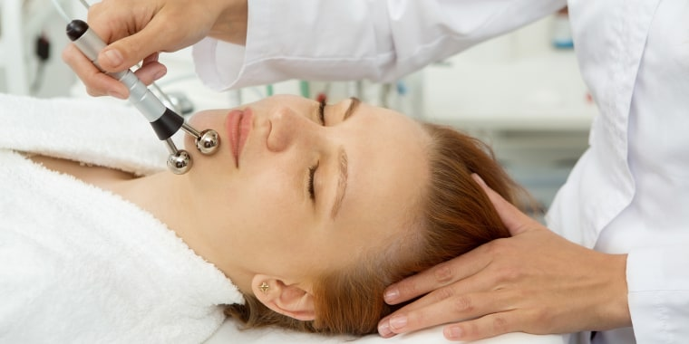 Beautiful woman receiving facial treatment