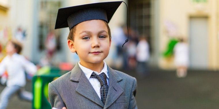 Toddler boy at preschool graduation