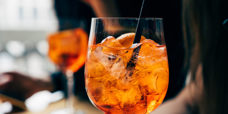Two women with aperol spritz drinks