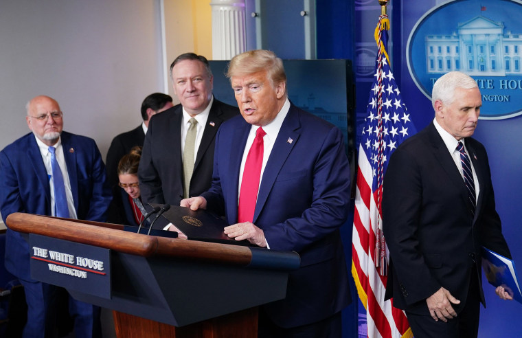 Image: CDC Director Robert R. Redfield, Secretary of States Mike Pompeo, President Donald Trump and Vice President Mike Pence arrive to participate in the daily briefing on the novel coronavirus, COVID-19, in the Brady Briefing Room at the White House