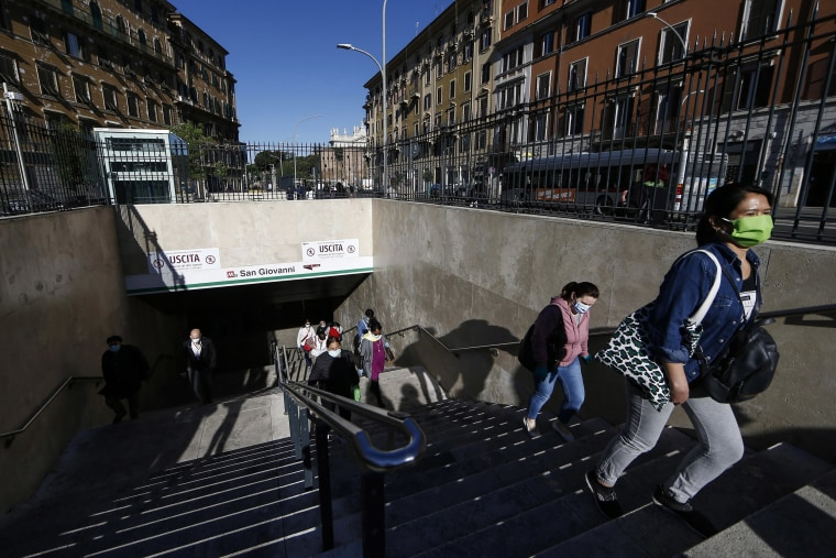 Image: People flow out of San Giovanni subway station in Rome