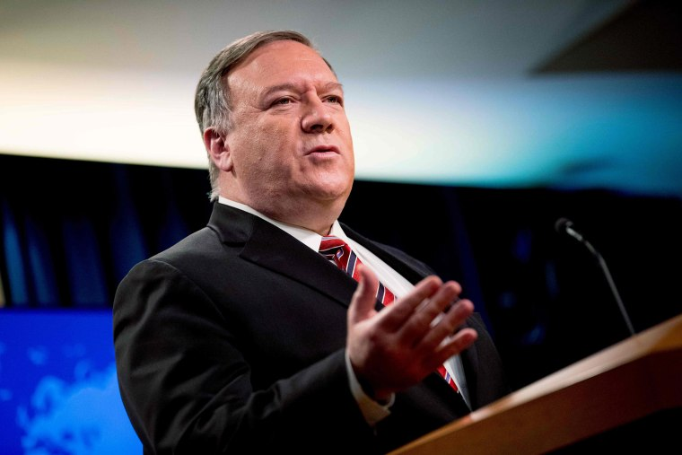 Image: Secretary of State Mike Pompeo pauses while speaking at a news conference at the State Department