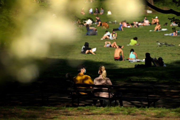Image: People relax in Brooklyn's Prospect Park on May 2, 2020. The New York City Parks Department has kept parks open, but require people to practice social distancing.