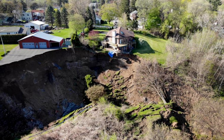 Image: A landslide in Waterford, N.Y., left a house teetering on the edge of a cliff on May 3, 2020.