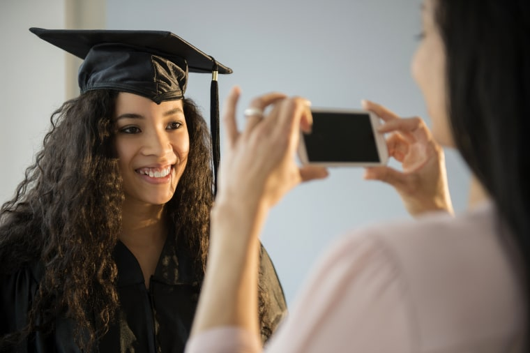 Image: Mother photographing daughter at graduation
