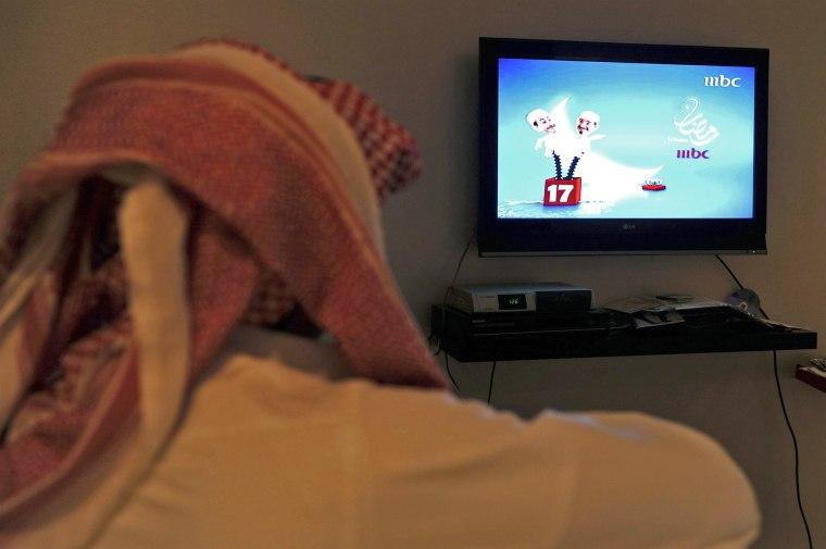 A Saudi man watches Saudi TV during the holy month of Ramadan.