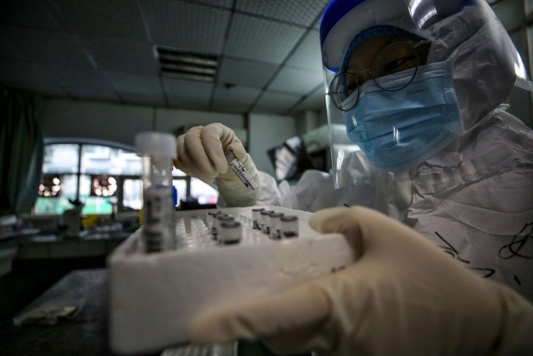 Image: A medical staff member holds samples from patients infected by COVID-19 in Wuhan, China,