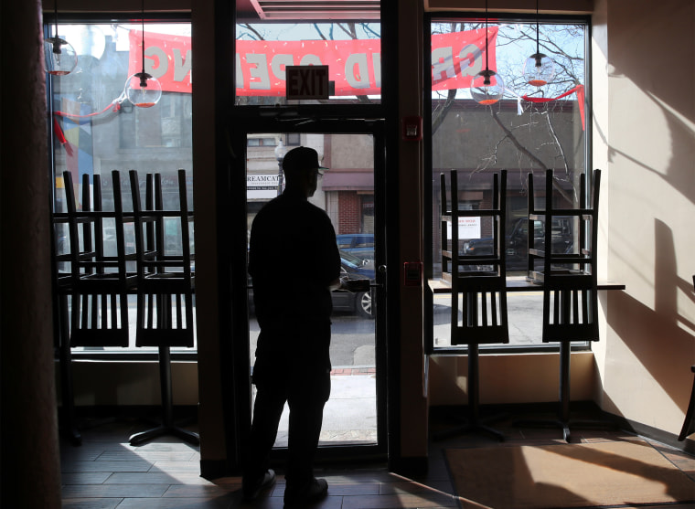 Owner and chef Anthony Caldwell looks out from 50Kitchen in the Field's Corner neighborhood of Boston on March 18, 2020.