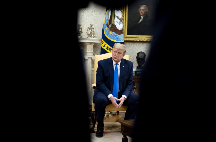 Image: President Donald Trump listens during a meeting with Iowa Governor Kim Reynolds on reopening businesses amid coronavirus at the Oval Office on May 6, 2020.