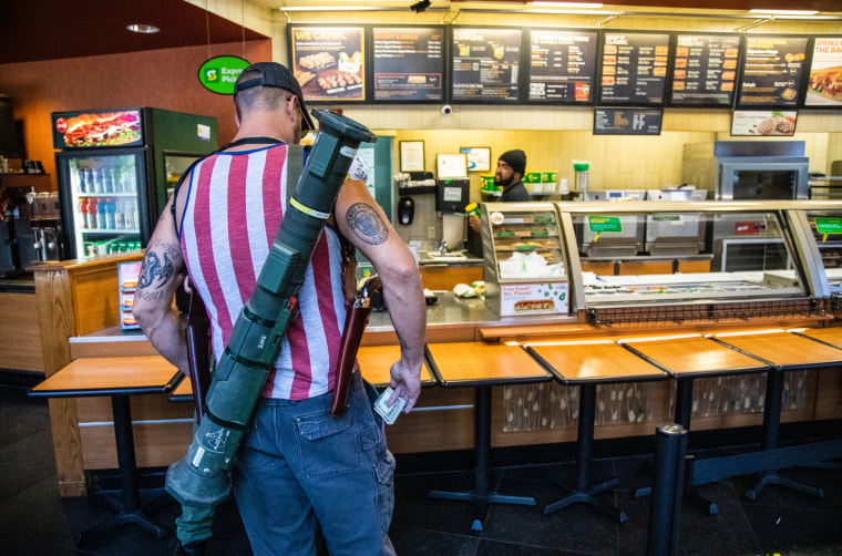 Several armed demonstrators protesting North Carolina's stay-at-home order visited a sandwich shop in Raleigh on Saturday, May 9, 2020, and were captured in photographs that went viral.